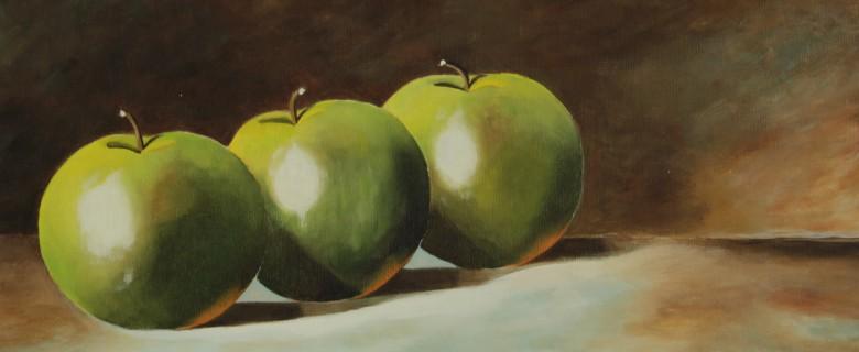 Drie groene appels op tafel